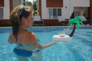 """The swimming pool at or near Coral Village - """"Caribbean Cocktails"""" Deluxe Suites & Pool"""