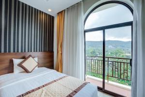 Кровать или кровати в номере Nesta Phu Quoc Hotel