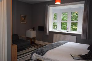 A bed or beds in a room at Torwood House