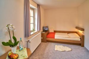 Ein Bett oder Betten in einem Zimmer der Unterkunft Ev.Familienferien-und Bildungsstätte Ebernburg