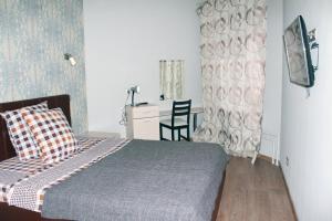 Кровать или кровати в номере Apartments on Stepana Razina