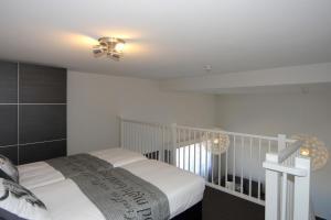 Een bed of bedden in een kamer bij Overtoom 60, Papendrecht