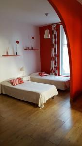 Un ou plusieurs lits dans un hébergement de l'établissement Ferme de l'Abbaye