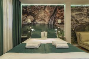 Cama o camas de una habitación en Hotel Ciudad del Mar