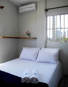 Cama ou camas em um quarto em Flat Pousada da Praia