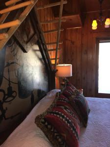 A bed or beds in a room at McMenamins Kalama Harbor Lodge
