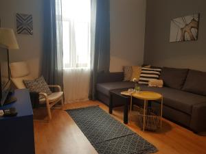 A seating area at Radomir Downtown Apartments
