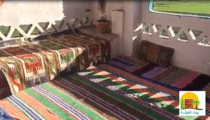 A bed or beds in a room at Rural Guest House بيت العيلة