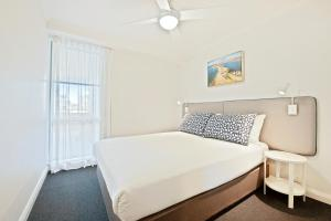 A bed or beds in a room at Quest Newcastle