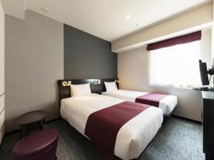 Кровать или кровати в номере Hotel Villa Fontaine Tokyo-Otemachi