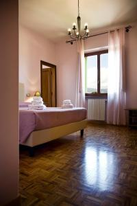 A bed or beds in a room at Casale Dell'Orso