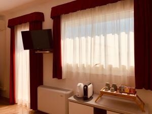 TV/Unterhaltungsangebot in der Unterkunft Hotel Verdi