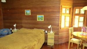 A bed or beds in a room at Pousada Floresta Negra