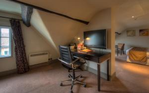 A television and/or entertainment center at The Greswolde Arms Hotel by Greene King Inns