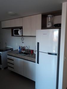 A cozinha ou cozinha compacta de Apartamento Maceio Facilities