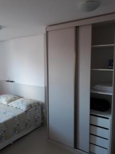 Cama ou camas em um quarto em Apartamento Maceio Facilities