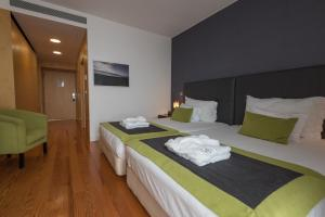 A bed or beds in a room at ARTS IN Hotel Conde Carvalhal