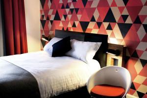Cama o camas de una habitación en Cityroomz Edinburgh