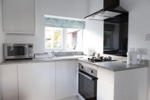 A kitchen or kitchenette at Elm Cottage Touring Park