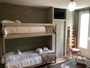 A bunk bed or bunk beds in a room at Auberge de L'Etang