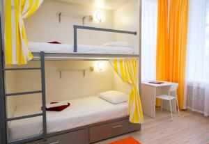 A bunk bed or bunk beds in a room at Voyage Hotel & Hostel