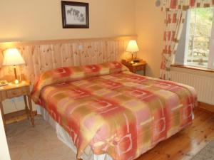 A bed or beds in a room at Ard na Breatha House