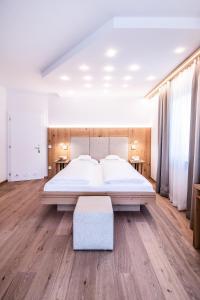 Ein Bett oder Betten in einem Zimmer der Unterkunft Hotel Rose
