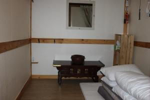 A seating area at Charm Hanok Guest House