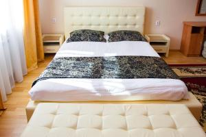 A bed or beds in a room at Ak Samal Hotel