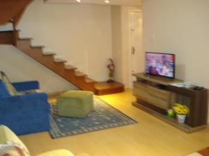 A television and/or entertainment centre at Apartamento/Duplex Suite 2D Wi-Fi