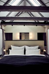 A bed or beds in a room at Fisher's Loft Hotel