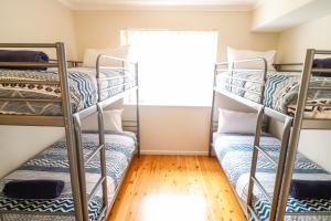 A bunk bed or bunk beds in a room at Coastal Horizons Beach House