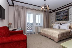 Кровать или кровати в номере Апарт-отель Губернский
