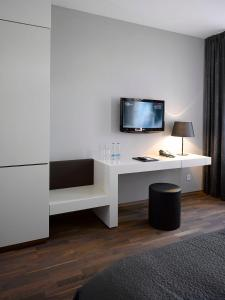 A television and/or entertainment center at MOODs boutique hotel