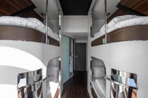 A bunk bed or bunk beds in a room at Steel House Copenhagen