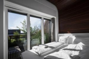 Letto o letti in una camera di Steel House Copenhagen