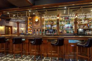 The lounge or bar area at Ferryhill House Hotel