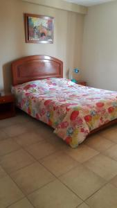 A bed or beds in a room at Hostal La Casona