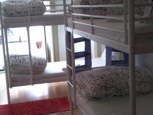 A bunk bed or bunk beds in a room at Santarem Hostel