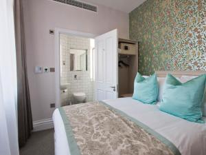 A bed or beds in a room at W12 Rooms