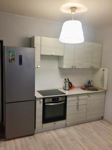 Кухня или мини-кухня в Апартаменты Акварель 3
