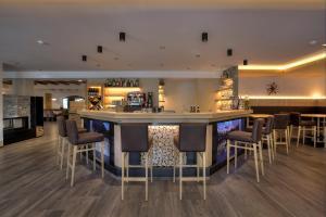 Lounge oder Bar in der Unterkunft Hotel Rose