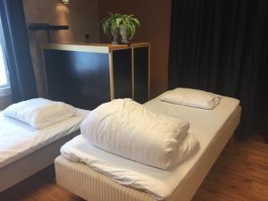 Säng eller sängar i ett rum på Malmköpings Bad & Camping