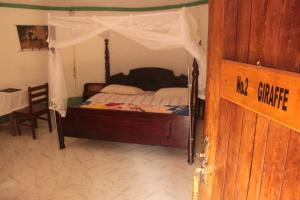 A bed or beds in a room at Salem Uganda Guesthouse
