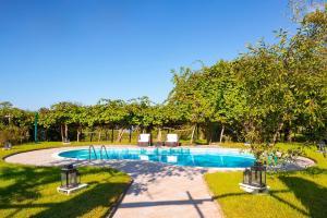 The swimming pool at or close to La Dimora