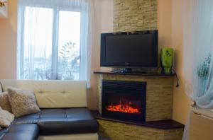 Телевизор и/или развлекательный центр в Гостевой Дом У Галины