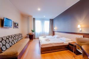 Posteľ alebo postele v izbe v ubytovaní Congress Hotel Centrum