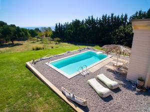 The swimming pool at or near Driftwood Villa