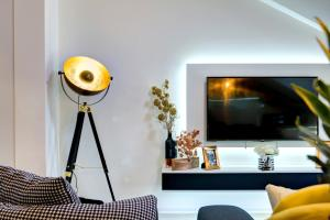 A television and/or entertainment center at Luxury apartment CRYSTAL