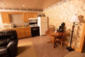 A kitchen or kitchenette at Blue Spruce Motel